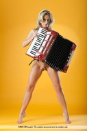 Naked Babe Plays the Accordion - pics 01