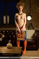 Nika Poses in Orange Stockings - pics 00