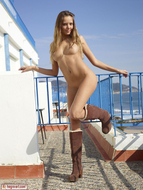 Sweet Teenager on the Balcony - pics 02