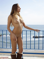 Sweet Teenager on the Balcony - pics 06