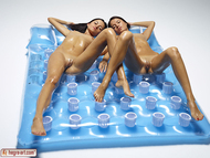 Shiny Girls on a Beach Mattress - pics 01