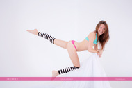 hot redhead in striped stockings - pics 00