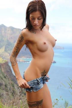 Silvia Dellai Peeing on the Cliff - pics 05