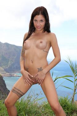 Silvia Dellai Peeing on the Cliff - pics 13
