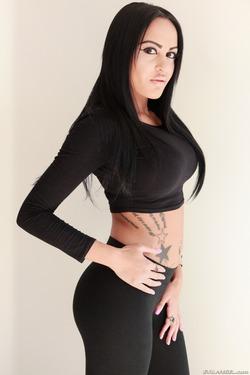 Tattooed Slut in Black Spandex - pics 01