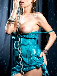 Soaking Wet Busty Babe in Chains