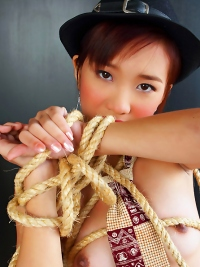 Asian Babe Covered with Ropes