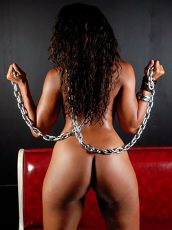 Dirty Ebony Bombshell in Chains and Heels on her Leather Chair