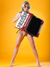 Naked Babe Plays the Accordion