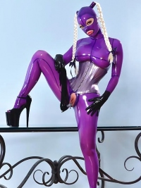 Latex Lucy Fucks Herself Wildly