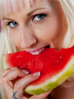 Blonde Undressing and Rubbing her Pussy with Juicy Water Melon