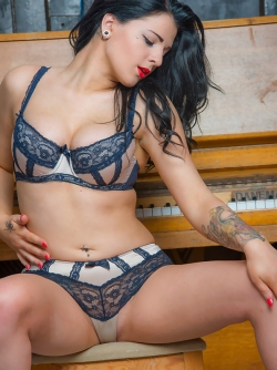 Dark Haired Bombshell Taking off her Lace Lingerie by the Piano