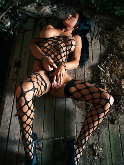 Raven Haired Busty Demon Rebeka in Black Fishnet Body Stockings