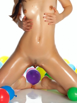 Oiled Cutie with Colourful Baloons