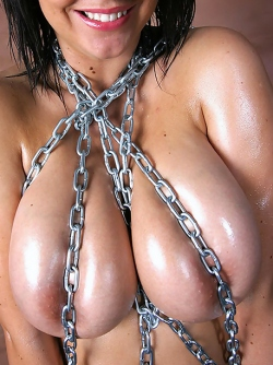 Naughty Milf with Natural Boobs Kora Kryk Oiled up and Chained