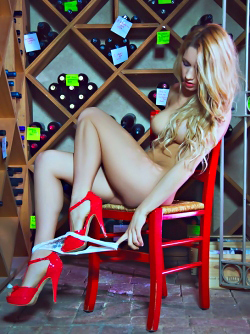 Toned Blonde Playmate in White Pants and Fiery Red High Heels