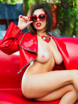 Glamour Model Darcie Dolce Poses in Shiny Red Leather Outside
