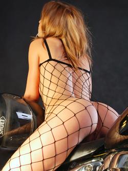 Big Titted Slut Emma Riding a Big Chopper in Sexy Fishnet Body