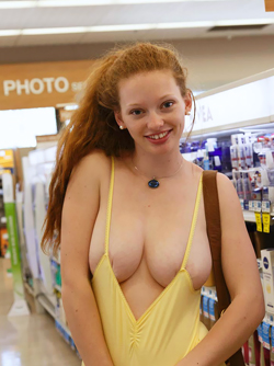 Fluffy Redhead Pussycat Wendy Shows her Fine Boobies in Public