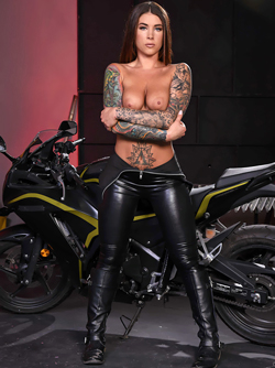 Bloodthirsty Biker Babe in Latex Catsuit and Long Leather Boots