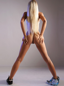 Platinum Blonde Beauty Marketa Belohona Slips out of Printed Bikini
