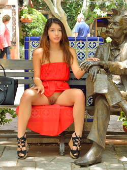 The Sexy One in Red - Melody Flashing her Shaved Pussy in Public